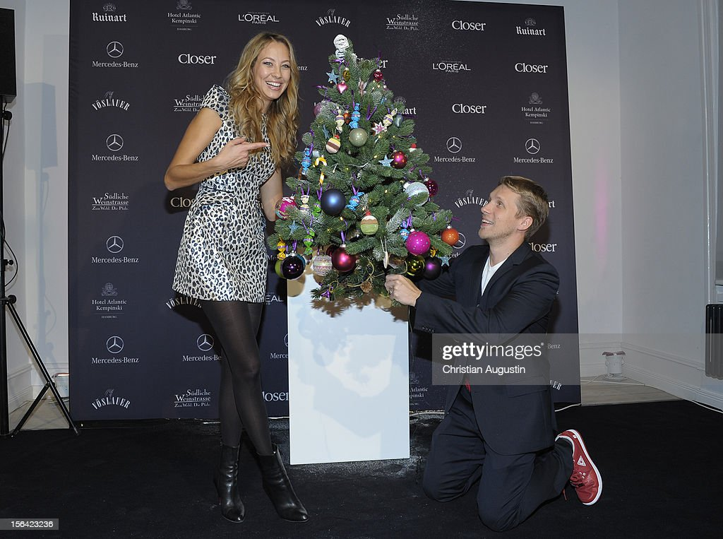 Alessandra Pocher and Oliver Pocher show a decorated Christmas Tree during the Charity Event SMILE for the magazine 'Closer' on November 14 2012 in...