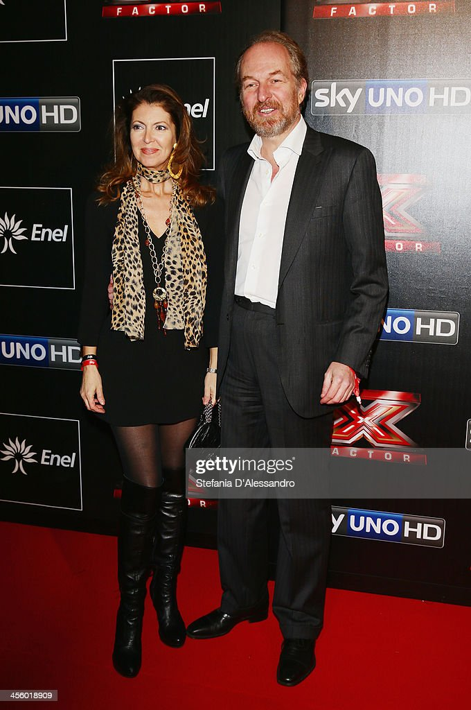 Alessandra Repini (L) and Arturo Artom (R) attend 'X Factor 2013 - The Final' Red Carpet on December 12, 2013 in Milan, Italy.