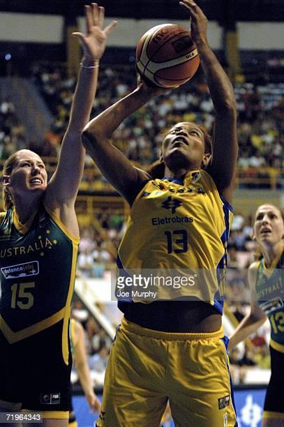 Alessandra Santos Olivei of Brazil shoots past Lauren Jackson of Australia during a game between Brazil and Australia during the 2006 FIBA World...
