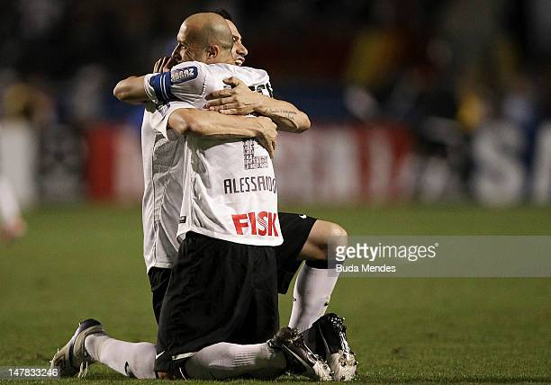 Alessandro and Chicao of Corinthians celebrate a scored goal of Emerson during the second leg of the final of the Copa Libertadores 2012 between Boca...