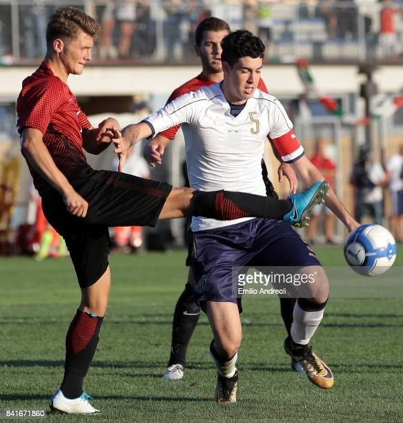 Alessandro Bastoni of Italy competes for the ball with Keskin Ramazan of Turkey during the U19 international friendly match between Italy U19 and...
