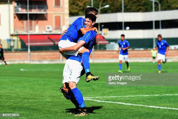 Alessandro Bastoni of Italy U19 celebrates after scoring the 11 goal during the match between Italy U19 and Russia U19 at Stadio Mirabello on...