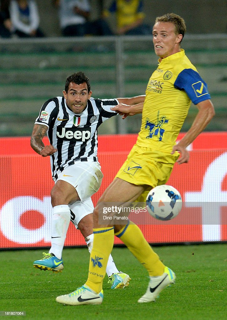 Alessandro Bernardini (R) of AC Chievo Verona competes with <a gi-track='captionPersonalityLinkClicked' href=/galleries/search?phrase=Carlos+Tevez&family=editorial&specificpeople=220555 ng-click='$event.stopPropagation()'>Carlos Tevez</a> of Juventus during the Serie A match between AC Chievo Verona and Juventus at Stadio Marc'Antonio Bentegodi on September 25, 2013 in Verona, Italy.