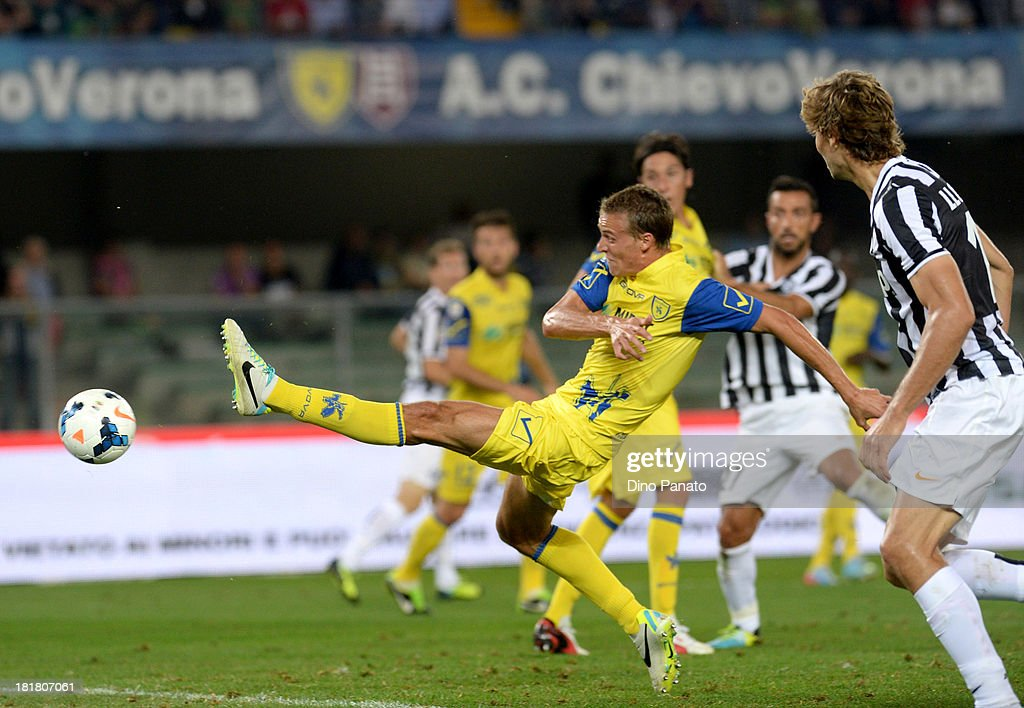 Alessandro Bernardini of AC Chievo Verona scores an own goal during the Serie A match between AC Chievo Verona and Juventus at Stadio Marc'Antonio Bentegodi on September 25, 2013 in Verona, Italy.