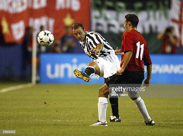 Alessandro Birindelli of Juventus kicks the ball past Ryan Giggs of Manchester United during the friendly USA Tour match between Manchester United...