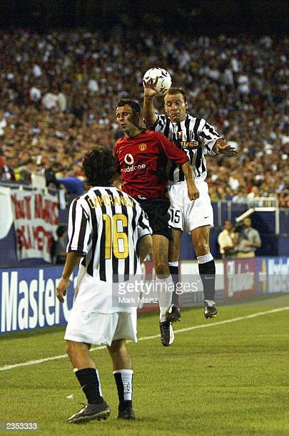 Alessandro Birindelli of Juventus vies for the ball against Ryan Giggs of Manchester United during the friendly USA Tour match between Manchester...