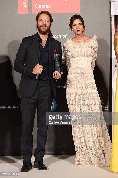 Alessandro Borghi receives the 'Best Supporting Actor' Award from Rocio Munoz Morales at the Kineo Diamanti Award Ceremony during the 73rd Venice...