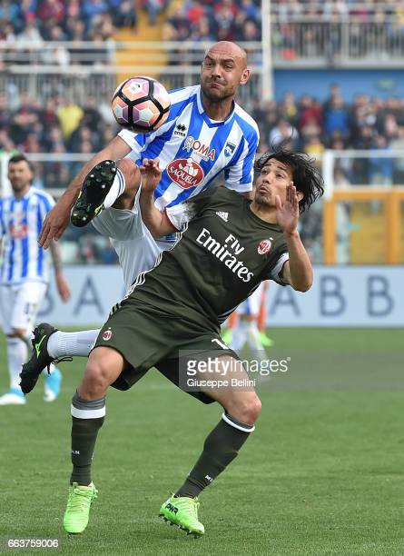 Alessandro Bruno of Pescara Calcio and Mati Fernandez of AC Milan in action during the Serie A match between Pescara Calcio and AC Milan at Adriatico...