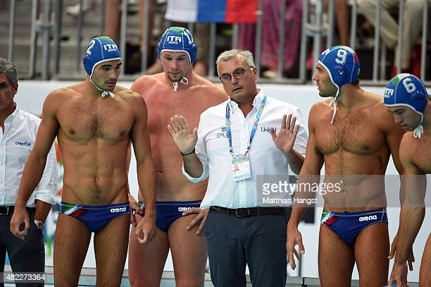 Alessandro Campagna head coach of Italy talks with his team prior to their Men's Water Polo Preliminary Round Group B match between Russia and Italy...