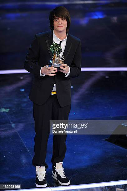 Alessandro Casillo winner of the 'Sanremo Social' shows her trophy on stage during the closing night of the 62th Sanremo Song Festival at the Ariston...