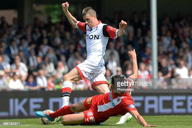 Alessandro Cerigioni of OH Leuven battles for the ball with Thibault Peyre of Mouscron during match day 1 of the Final Round in the second division...