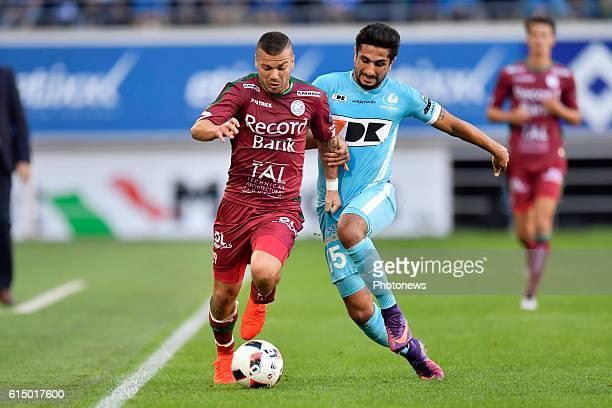 Alessandro Cordaro midfielder of SV Zulte Waregem is challenged by Kenneth Saief midfielder of KAA Gent during the Jupiler Pro League match between...