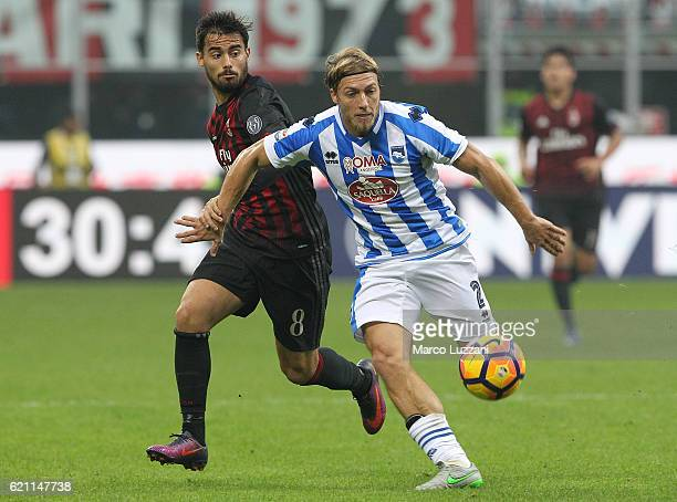 Alessandro Crescenzi of Pescara Calcio competes for the ball with Suso of AC Milan during the Serie A match between AC Milan and Pescara Calcio at...