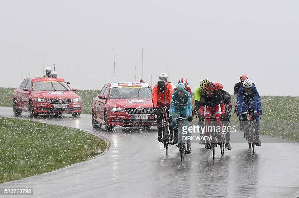 Alessandro De Marchi Paolo Tiralongo Nicolas Edet and Jeremy Roy part of an eightmen leading group ride through the snow during the 102nd edition of...