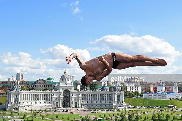 Alessandro De Rose of Italy competes in the Men's High Diving 27m preliminary round on day ten of the 16th FINA World Championships at the Kazanka...