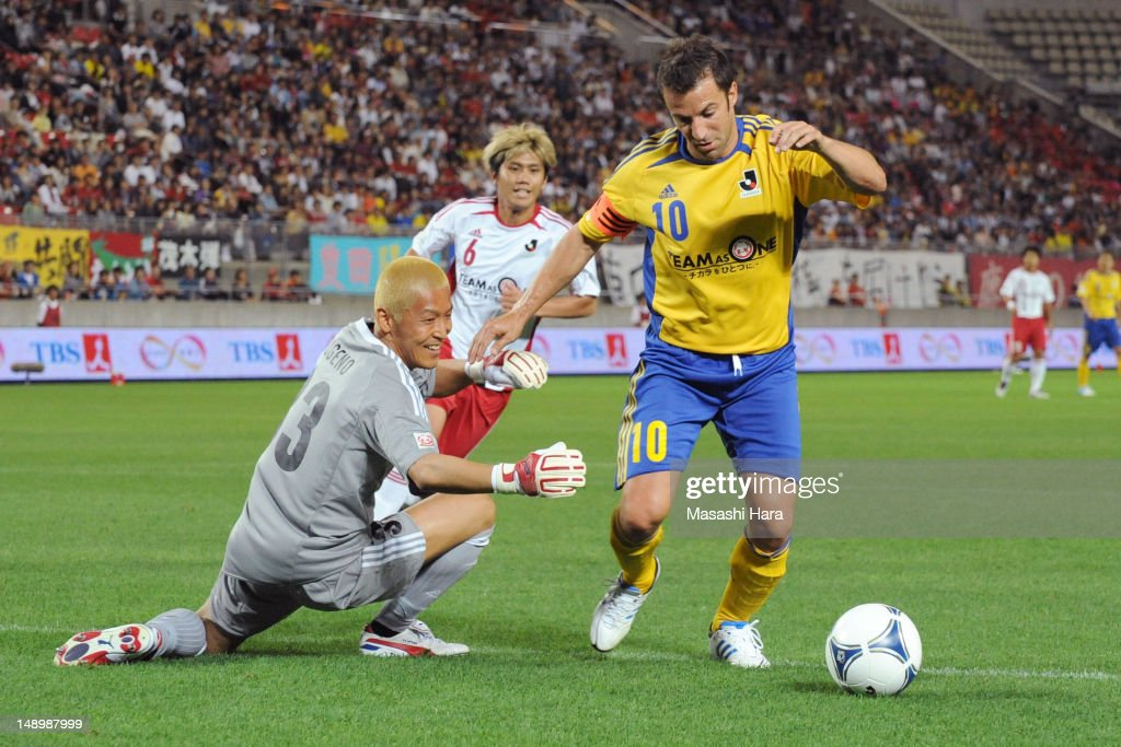 <a gi-track='captionPersonalityLinkClicked' href=/galleries/search?phrase=Alessandro+Del+Piero&family=editorial&specificpeople=206226 ng-click='$event.stopPropagation()'>Alessandro Del Piero</a> #10 (R) in action during the J.League special match at Kashima Soccer Stadium on July 21, 2012 in Kashima, Japan. The match is being held to raise money for the victims of last year's earthquake and tsunami.