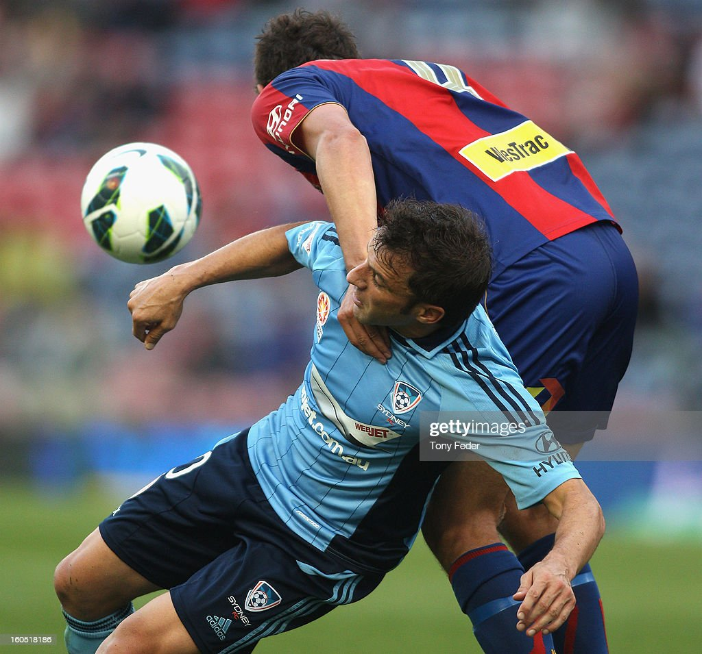 <a gi-track='captionPersonalityLinkClicked' href=/galleries/search?phrase=Alessandro+Del+Piero&family=editorial&specificpeople=206226 ng-click='$event.stopPropagation()'>Alessandro Del Piero</a> is tackled by his Jets opponent during the round 19 A-League match between the Newcastle Jets and Sydney FC at Hunter Stadium on February 2, 2013 in Newcastle, Australia.
