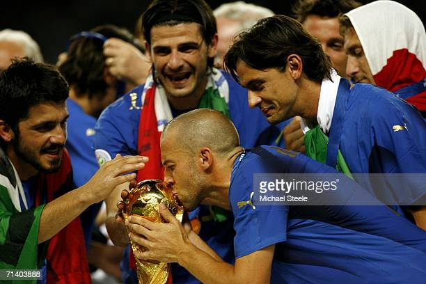 Alessandro Del Piero of Italy kisses the world cup trophy after the FIFA World Cup Germany 2006 Final match between Italy and France at the Olympic...