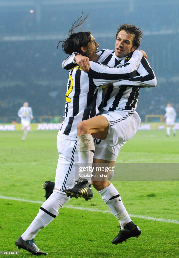 <a gi-track='captionPersonalityLinkClicked' href=/galleries/search?phrase=Alessandro+Del+Piero&family=editorial&specificpeople=206226 ng-click='$event.stopPropagation()'>Alessandro Del Piero</a> (R) of Juventus FC celebrates his first goal with <a gi-track='captionPersonalityLinkClicked' href=/galleries/search?phrase=Jose+Martin+Caceres&family=editorial&specificpeople=4948425 ng-click='$event.stopPropagation()'>Jose Martin Caceres</a> during the Tim Cup match between Juventus FC and SSC Napoli at Olimpico Stadium on January 13, 2010 in Turin, Italy.