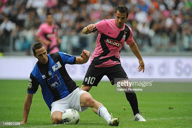 Alessandro Del Piero of Juventus FC is challenged by Riccardo Cazzola of Atalanta BC during the Serie A match between Juventus FC and Atalanta BC at...