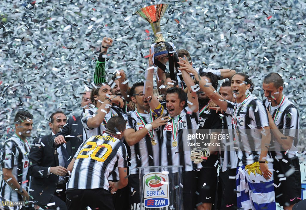 Alessandro Del Piero of Juventus FC lifts the Serie A trophy in his last match for the club as he celebrates winning the championship with teammates...