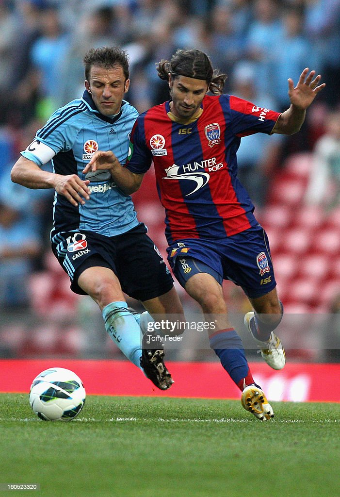 Alessandro Del Piero of Sydney and Zenon Caravella of the Jets contest the ball during the round 19 A-League match between the Newcastle Jets and Sydney FC at Hunter Stadium on February 2, 2013 in Newcastle, Australia.