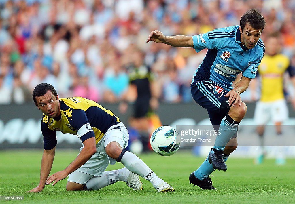 Alessandro Del Piero of Sydney competes with John Hutchinson of the Mariners during the round 13 A-League match between Sydney FC and the Central Coast Mariners at Allianz Stadium on December 27, 2012 in Sydney, Australia.