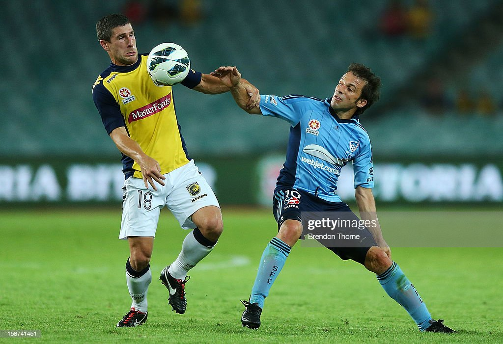 Alessandro Del Piero of Sydney competes with Nick Montgomery of the Mariners during the round 13 A-League match between Sydney FC and the Central Coast Mariners at Allianz Stadium on December 27, 2012 in Sydney, Australia.