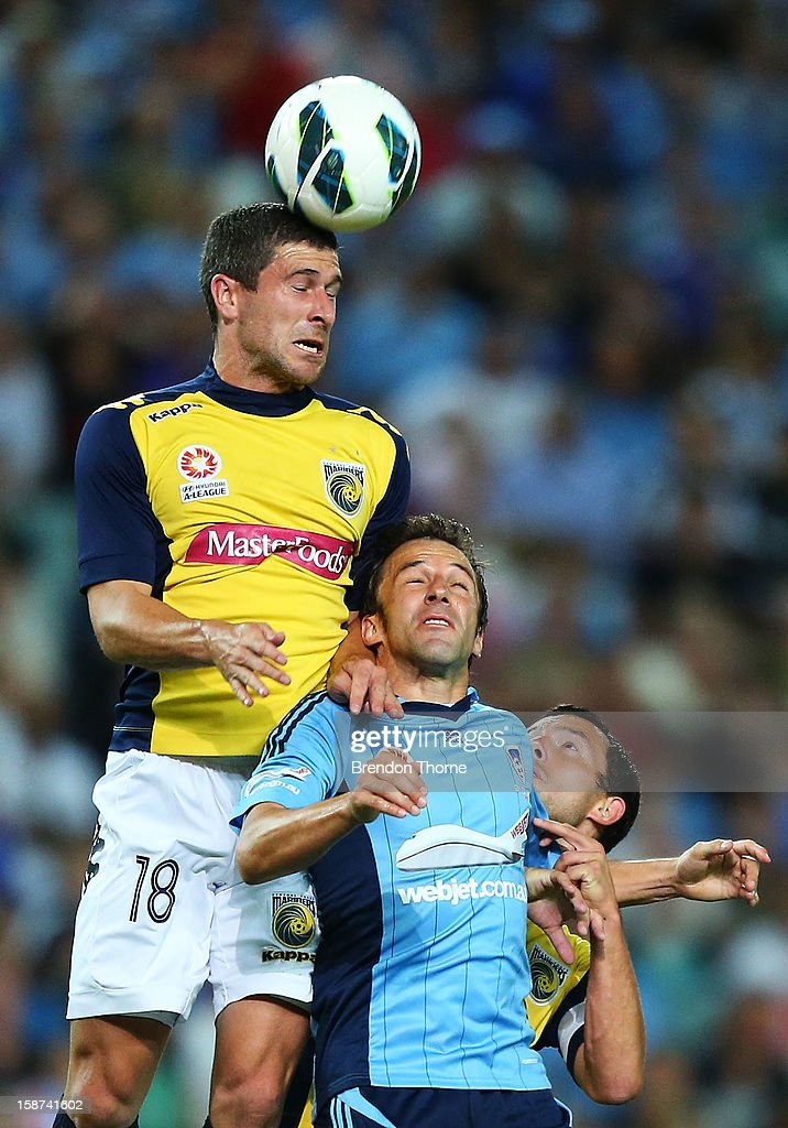Alessandro Del Piero of Sydney competes with <a gi-track='captionPersonalityLinkClicked' href=/galleries/search?phrase=Nick+Montgomery&family=editorial&specificpeople=687409 ng-click='$event.stopPropagation()'>Nick Montgomery</a> of the Mariners during the round 13 A-League match between Sydney FC and the Central Coast Mariners at Allianz Stadium on December 27, 2012 in Sydney, Australia.