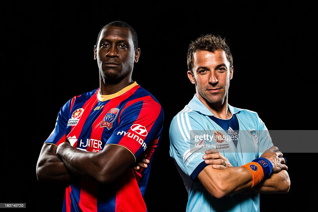Alessandro Del Piero of Sydney FC and Emile Heskey of Newcastle Jets pose during the 2013/14 ALeague Season Launch at Allianz Stadium on October 8...
