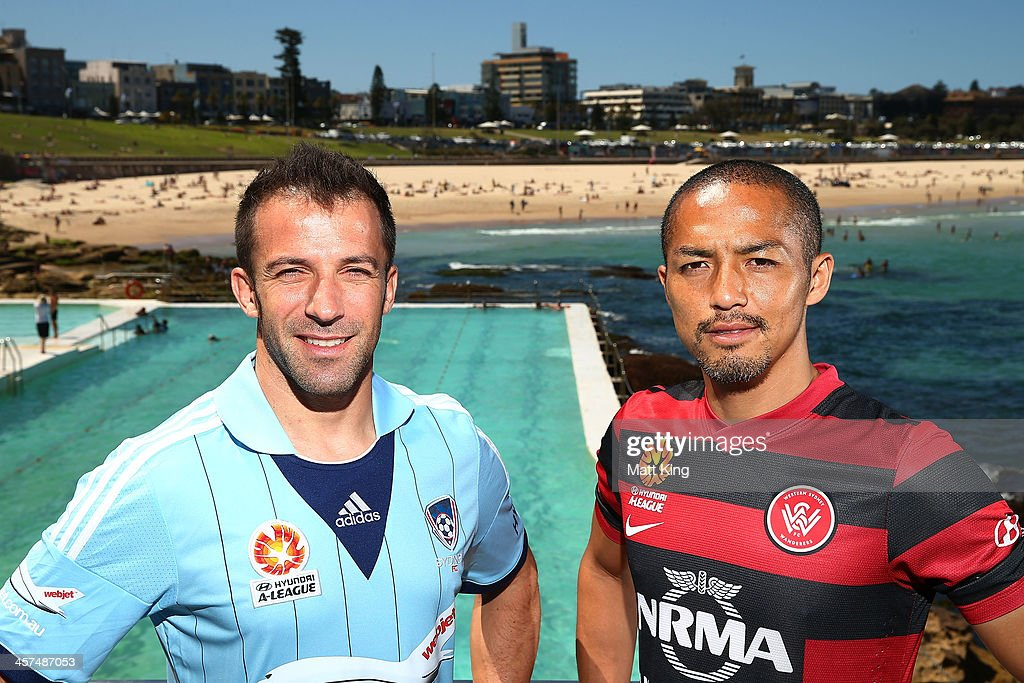 <a gi-track='captionPersonalityLinkClicked' href=/galleries/search?phrase=Alessandro+Del+Piero&family=editorial&specificpeople=206226 ng-click='$event.stopPropagation()'>Alessandro Del Piero</a> of Sydney FC (L) and <a gi-track='captionPersonalityLinkClicked' href=/galleries/search?phrase=Shinji+Ono&family=editorial&specificpeople=550970 ng-click='$event.stopPropagation()'>Shinji Ono</a> of the Western Sydney Wanderers (R) pose during the launch of the A-League's Summer of Football at Bondi Icebergs on December 18, 2013 in Sydney, Australia.
