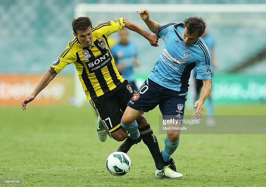 Alessandro Del Piero of Sydney FC and Vince Lia of the Phoenix compete for the ball during the round 17 A-League match between Sydney FC and the Wellington Phoenix at Allianz Stadium on January 19, 2013 in Sydney, Australia.