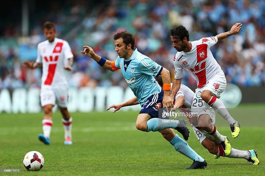 Alessandro Del Piero of Sydney FC beats the defence on the way to scoring the first goal during the round 10 A-League match between Sydney FC and the Melbourne Heart at Allianz Stadium on December 15, 2013 in Sydney, Australia.