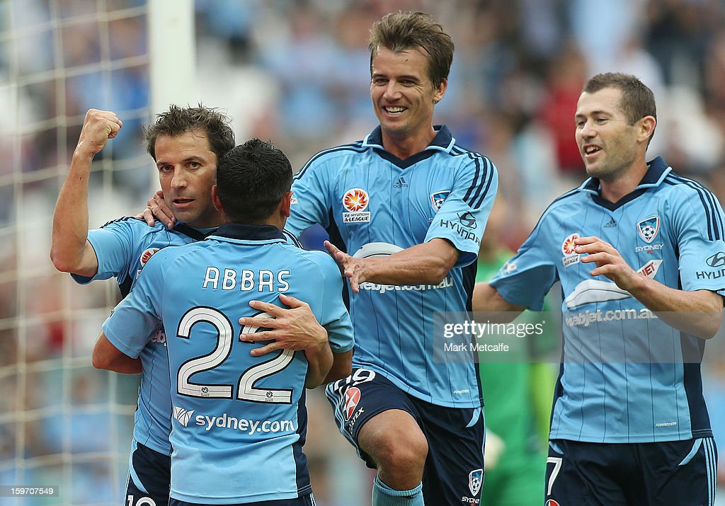 Alessandro Del Piero of Sydney FC celebrates with teammates Joel Griffiths, Ali Abbas and Brett Emerton after scoring a goal during the round 17 A-League match between Sydney FC and the Wellington Phoenix at Allianz Stadium on January 19, 2013 in Sydney, Australia.