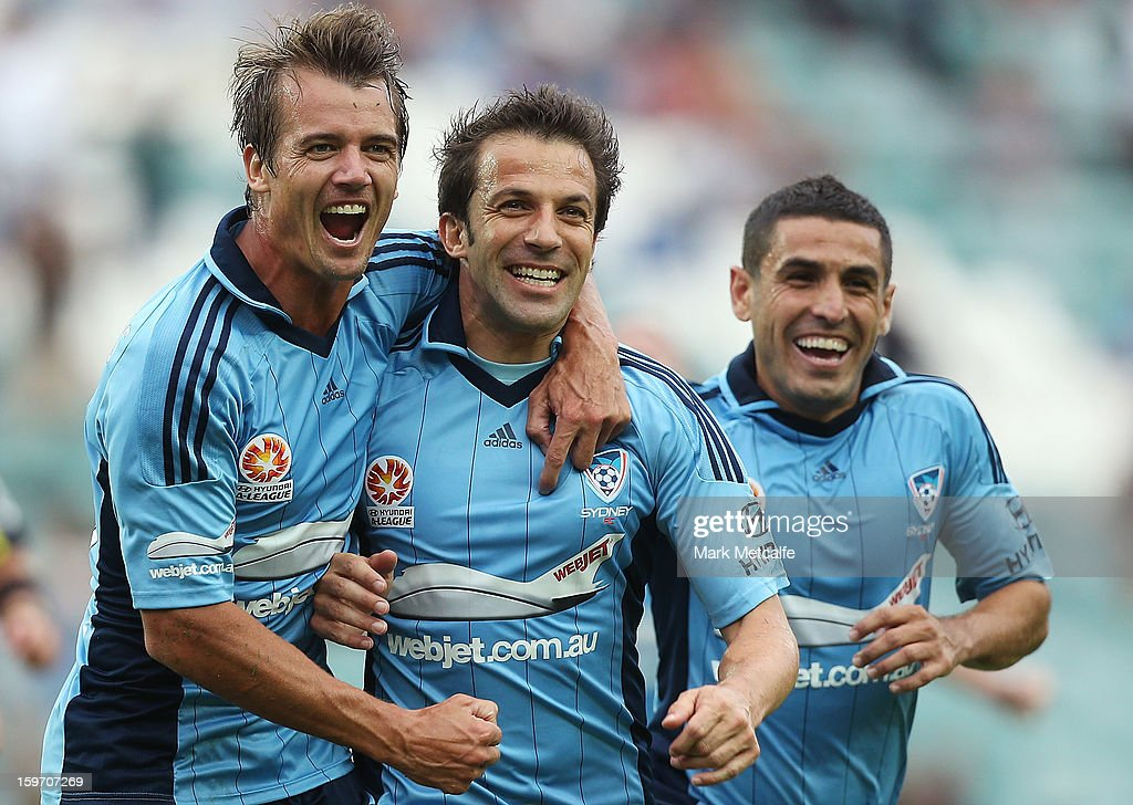 Alessandro Del Piero of Sydney FC celebrates with teammates Joel Griffiths and Ali Abbas after scoring a goal during the round 17 A-League match between Sydney FC and the Wellington Phoenix at Allianz Stadium on January 19, 2013 in Sydney, Australia.
