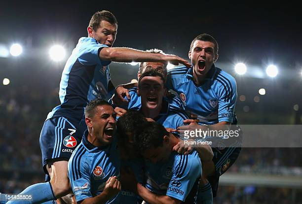 Alessandro Del Piero of Sydney FC is congratulated by team mates after he scored his team's first goal during the round three ALeague match betwen...