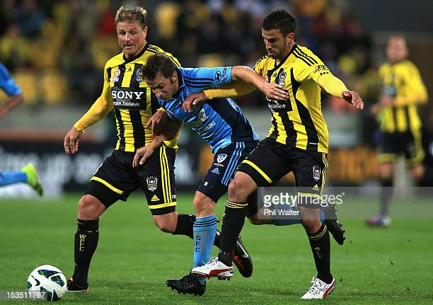 Alessandro Del Piero of Sydney FC is tackled by Emmanuel Muscat and Ben Sigmund of the Phoenix during the round one ALeague match between the...