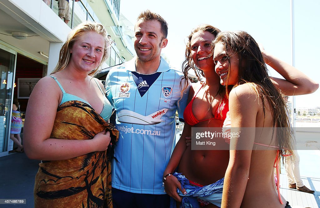 Alessandro Del Piero of Sydney FC poses with girls in bikinis during the launch of the A-League's Summer of Football at Bondi Icebergs on December 18, 2013 in Sydney, Australia.