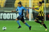 Alessandro Del Piero of Sydney FC runs the ball under pressure from Leo Bertos of the Phoenix during the round one ALeague match between the...