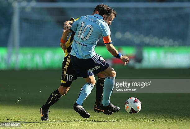 Alessandro Del Piero of Sydney is challenged by Ben Sigmund of the Phoenix during the round seven ALeague match between Sydney FC and the Wellington...