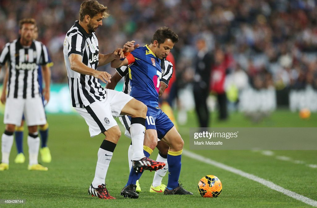 <a gi-track='captionPersonalityLinkClicked' href=/galleries/search?phrase=Alessandro+Del+Piero&family=editorial&specificpeople=206226 ng-click='$event.stopPropagation()'>Alessandro Del Piero</a> of the All Stars is challenged by <a gi-track='captionPersonalityLinkClicked' href=/galleries/search?phrase=Fernando+Llorente&family=editorial&specificpeople=2108120 ng-click='$event.stopPropagation()'>Fernando Llorente</a> and <a gi-track='captionPersonalityLinkClicked' href=/galleries/search?phrase=Patrice+Evra&family=editorial&specificpeople=714865 ng-click='$event.stopPropagation()'>Patrice Evra</a> of Juventus during the match between the A-League All Stars and Juventus at ANZ Stadium on August 10, 2014 in Sydney, Australia.