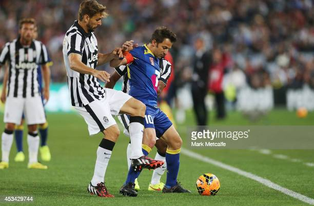Alessandro Del Piero of the All Stars is challenged by Fernando Llorente and Patrice Evra of Juventus during the match between the ALeague All Stars...