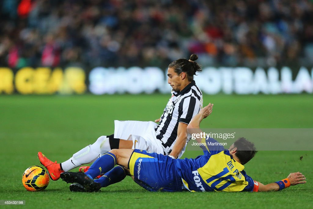 Alessandro del Piero of the All Stars tackles Martin Caceres of Juventus during the match between the ALeague All Stars and Juventus at ANZ Stadium...