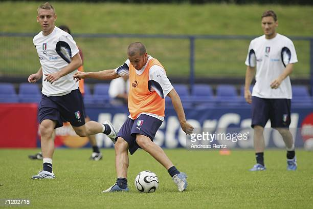 Alessandro Del Piero shoots as Daniele De Rossi and Francesco Totti look on during the Italy national football team training session on June 14 2006...