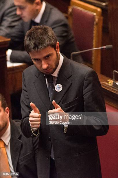 Alessandro Di Battista deputy of Five Stars Movement gestures as he attends the second session of the new Italian Parliament at the Chambers of...