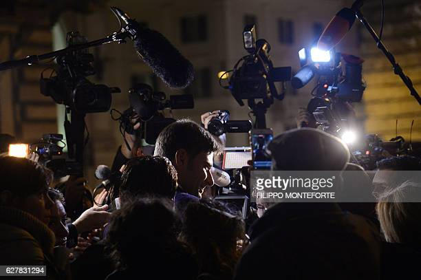 Alessandro Di Battista of the populist Five Star Movement speaks to journalists as he leaves the Italian Chamber of Deputies on December 5 2016 in...
