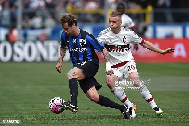 Alessandro Diamanti of Atalanta BC in action against Ignazio Abate of AC Milan during the Serie A match between Atalanta BC and AC Milan at Stadio...