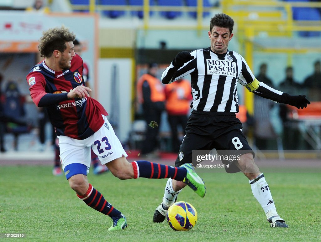 <a gi-track='captionPersonalityLinkClicked' href=/galleries/search?phrase=Alessandro+Diamanti&family=editorial&specificpeople=4891338 ng-click='$event.stopPropagation()'>Alessandro Diamanti</a> of Bologna and Simone Vergassola of Siena in action during the Serie A match between Bologna FC and AC Siena at Stadio Renato Dall'Ara on February 10, 2013 in Bologna, Italy.