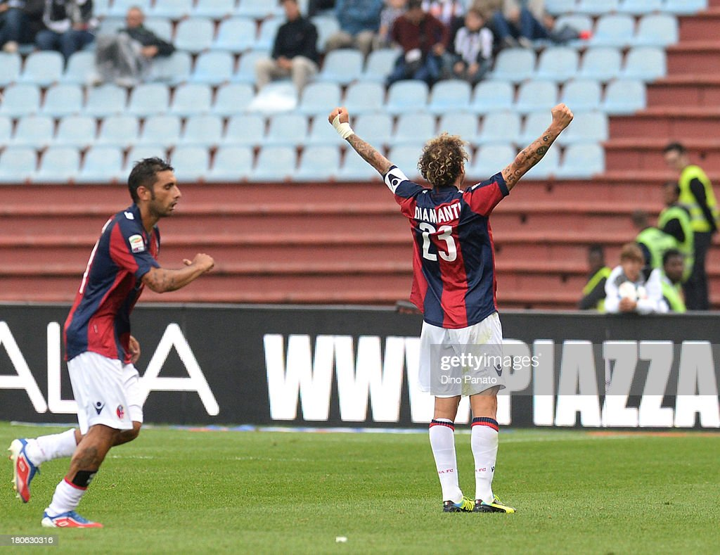 <a gi-track='captionPersonalityLinkClicked' href=/galleries/search?phrase=Alessandro+Diamanti&family=editorial&specificpeople=4891338 ng-click='$event.stopPropagation()'>Alessandro Diamanti</a> (R) of Bologna FC celebrates after scoring his opening goal during the Serie A match between Udinese Calcio and Bologna FC at Stadio Friuli on September 15, 2013 in Udine, Italy.