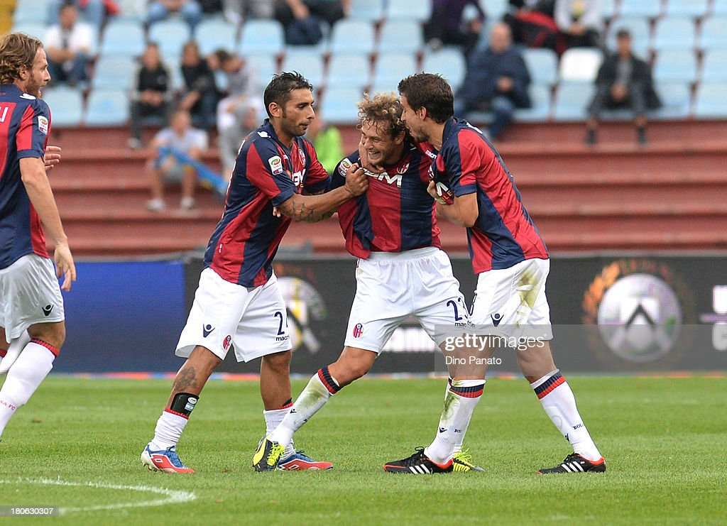 <a gi-track='captionPersonalityLinkClicked' href=/galleries/search?phrase=Alessandro+Diamanti&family=editorial&specificpeople=4891338 ng-click='$event.stopPropagation()'>Alessandro Diamanti</a> (C) of Bologna FC celebrates with their teams mate after scoring his opening goal during the Serie A match between Udinese Calcio and Bologna FC at Stadio Friuli on September 15, 2013 in Udine, Italy.